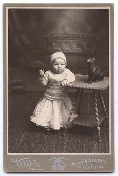 Cabinet card, portrait of a child with a knife and a chocolate bunny, Wilke, ca. 1880-1900's