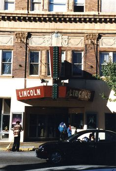 Lincoln Theater Belleville, IL  An employee sweeps up early-fall leaves as the Lincoln is spruced up for its 75th-birthday party.