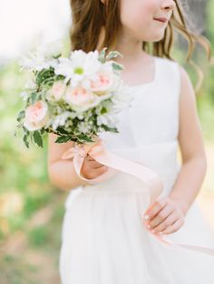 flower girl bouquet, photo by When He Found Her http://ruffledblog.com/brooklands-farm-wedding #flowers #flowergirl