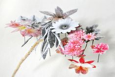 Dutch artistAnne Ten Donkelaarlays pressed wildflowers, dried stems, and paper cutouts on top of tiny little pins to create the most spectacular three dimensional collages.