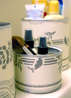 Use old formula or dry goods cans for make up organization.