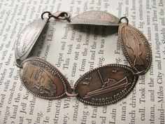How fun! Press penny at each vacation destination, and make a bracelet .