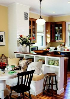Love how they used the half wall as a breakfast nook