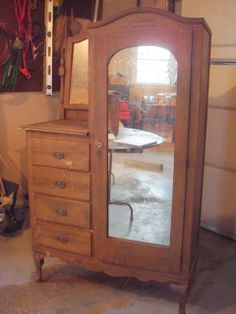 this type of dresser/armoire is called a chiffonier.  learn something new every day.