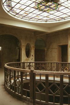 Something like this (from an abandoned old mansion) over the dining room, maybe the parlour.
