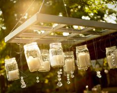mason jar candle chandelier http://www.ilovefarmweddings.com/2014/04/21/brittany-jonathan-married-in-georgia/