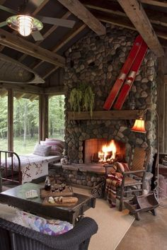 mountain cabin living - a porch with a sleeping bed and a warm fire...life is good!