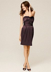 This short charmeuse dress is fun and stylish. The strapless neckline is sleek and fun. It has a ruched waist and pockets!   Wear this dress to a wedding and again for another special occasion.  The basic silhouette will keep this dress in your closet for years.  Fully lined. Back zip. Imported polyester. Dry clean only.  Available in store in sizes 2-30.  Get inspired by our colors..   To protect your dress, try our Non Woven Garment Bag.