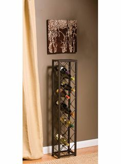 "Iron Wine Tower for $112.00 from WineRacks.com  Dimensions: 10"" w x 7"" d x 48"" h Capacity: 15 bottles  Metal wine rack holds up to 15 bottles in a simple grid"