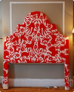 Not crazy about the pattern, but the post offers great step-by-step instructions on upholstering a headboard yourself. #DIY #headboard #fabric