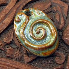 Ceramic Spiral Pendant by JeraLunaDesigns on Etsy, $8.00