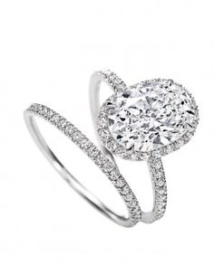 Oval-Cut Harry Winston Engagement Ring and Wedding Band