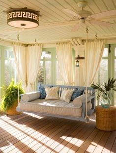 Every time we pass a house with a porch swing/couch/bed like this on one of our walks, Nick stops to show me. I feel this will be a must. | fabuloushomeblog.comfabuloushomeblog.com