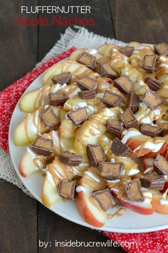 Fluffernutter Apple Nachos - apples drizzled with peanut butter, marshmallow, and Reese's PB cups.  Best way to eat an apple a day!
