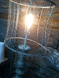 Chicken wire on to a vintage lampshade frame; base painted in Annie Sloan's Chalk Paint (tm) Decorative Paint in Old White with Annie's clear & dark wax. Brass harp painted in Old Ochre from Annie Sloan! For sale at Studio Eleven, Lynchburg, Va.