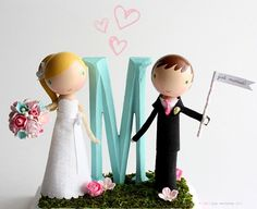 Lollipop workshop has customized cake toppers that can be made to look like the bride and groom! I adore these!