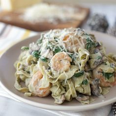 Creamy cauliflower alfredo sauce lets you have your favorite shrimp fettuccine without the guilt!