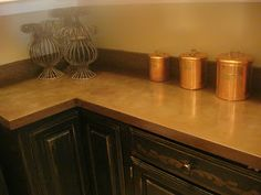 Faux Copper Countertops ~ She just painted the formica with spray paint!