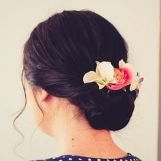 DIY Hairstyle: A really easy and simple tutorial on creating a floral twist with a plaited bun!