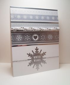 PRODUCT LIST    Stamp set:  Simple Snowflakes by Tami Mayberry for Gina K. Designs  Card Stock:  Gina K. Designs 120 lb Pure Luxury White  Embossing Powder:  Ranger in Silver  Other:  Patterned paper, white satin road and clear gem stones purchased at Archiver's    http://www.shop.ginakdesigns.com/product.sc?productId=1568=16
