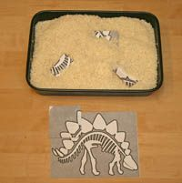 dinosaur fossil dig- in rice tray with paintbrush