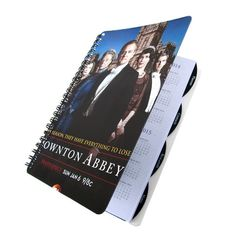"""Yes people still use day planners.  When the electronics crash this will still work.  Stay organized with a handmade planner / datebook featuring up-cycled artwork from TV's British series, DOWNTON ABBEY.  ☆ Dates range from JULY 2014 - DECEMBER 2015 ☆ Front/back covers and pages measure 8"""" by 5.5"""" ☆ Includes monthly and weekly organization. ☆ Sections for addresses, notes, a..."""