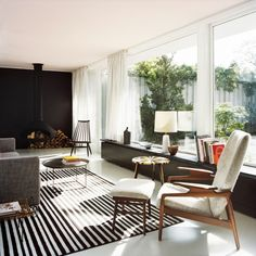 Atrium House by Bfs Design in Tiergarten Park, Berlin, feature black tile wall, black and white striped area rug| Remodelista