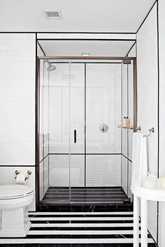 clean lines in the bathroom and striped marble floors