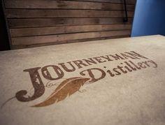 Not only for concrete floors, this concrete bartop features a custom logo.  Hard Topix Jenison, MI