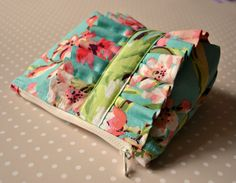 Cosmetics make up bag made with Amy Butler by CuriousMissClay. £18.00, via Etsy.