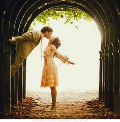 absolutely gorgeous photo. I love her dress, I love the scenery, and obviously I love the kiss.