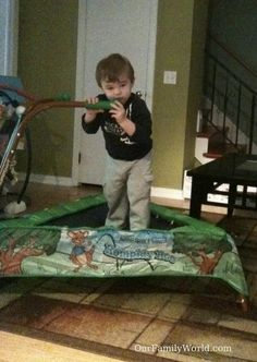 22 month boy chewing the JumpSport iBounce Kids Trampoline