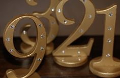Painted numbers with rhinestone accents -- perfect for identifying table numbers at parties or weddings.