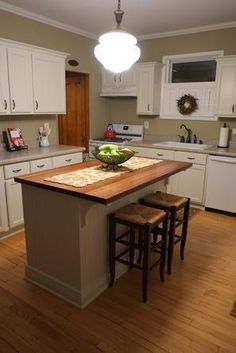 See how this reader used stock cabinets--trimmed, painted and topped with a wood counter--to create a custom DIY kitchen island. | thisoldhouse.com/yourTOH