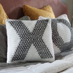 Make your own crochet and cross-stitch pillows with full instructions including cross-stitch chart.