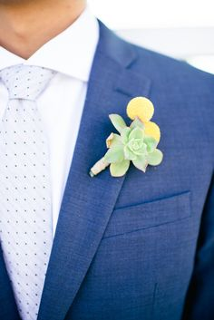 succulent and billy button boutonniere, photo by Jenna Bechtholt http://ruffledblog.com/los-angeles-rooftop-wedding #wedding #groom