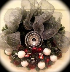 My own creation tonight!  Deco mesh and Chevy hubcap wreath with vintage model car ornaments and red light cover accents.