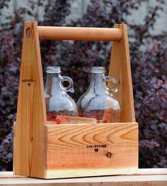 Growler Carrier By Meriwether of Montana. Handcrafted, gorgeous carrier for your microbrews. Genius. $32.