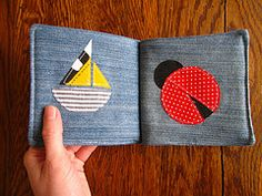 DIY soft baby book. It might be fun to do a series of traditional quilt blocks as different pages of the book. That's a sampler idea I could get behind.