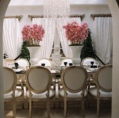 pink flowers white statue black goblets
