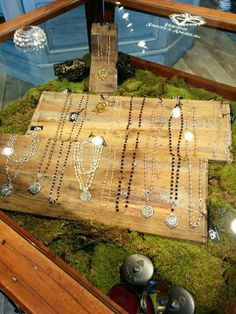 Merci Beaucoup Boutique jewelry display of Virgin Saints & Marys - Love this natural earthy look with beautiful jewels dripping