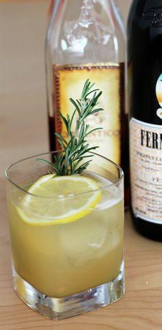 CIDER SMASH: Ice;  1½ ounces Atlantico dark rum;  ¼ ounce Fernet-Branca;  1 ounce fresh apple cider;  ¾ ounce fresh lemon juice;  ½ ounce agave syrup;  2 rosemary stalks, plus 1 more for garnish;  Lemon wheel, for garnish.