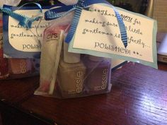 Hostess gifts for baby boy shower. Two finger nail polishes, a mini nail file and a polish remover pad.