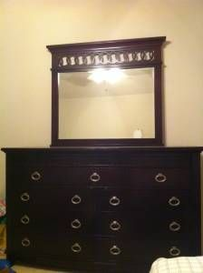 dark brown dresser with mirror