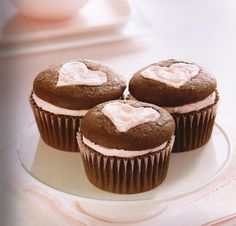 slice off top of cupcake and put frosting the bottom. use a cookie cutter to make cut out shape on the part of cupcake. replace top of cupcake on the frosting....from Fun Stuff cupcakes recipe book
