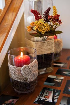 Red candle in coffee beans w/ burlap wrapped around.... white pumpkins stacked on glass beads, in tall square vase w/ twine wrapped. 10/6/12
