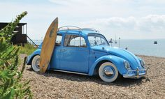 VW Beetle and surf board.