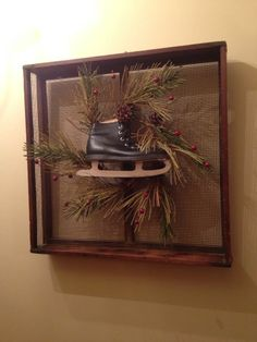 Old sieve with Christmas wreath and added a child's ice skate. The Duncan's Winchester, IL.