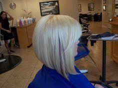 I made her platinum blonde with auburn peekaboos with a funky asymmetrical bob :)