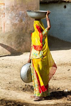 Rural India village woman's daily work routine. Outskirts of Jodhpur, India.